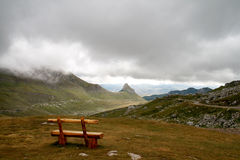 Wooden bench in a mountain valley Stock Image