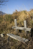 Wooden bench in the mountains Stock Photo