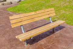 Wooden bench in national green park, for rest and relax. Stock Photos