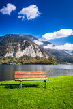 Wooden bench near a mountain lake Royalty Free Stock Images