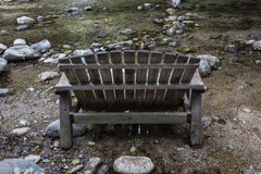 Wooden bench near river Royalty Free Stock Photos