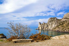 Wooden bench at the observation deck on the seashore. With views of the cliffs Stock Image
