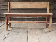 Wooden bench. Old wooden bench on the wooden floor Royalty Free Stock Photos