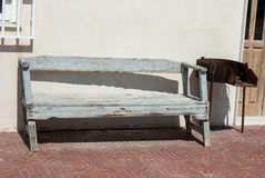 Wooden Bench. Old leaning blue wooden bench in spain Stock Photo