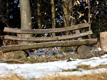 Wooden bench. Old romantic wooden bench on the edge of the forest stock photos