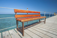 Wooden Bench On Tropical Jetty Stock Photo