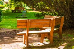 Wooden bench outdoors Stock Image