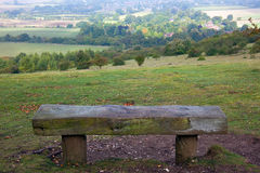Wooden bench overlooking English countryside. A wooden bench with a beautiful viewpoint over English countryside near to the town of Watlington in Oxfordshire Stock Images
