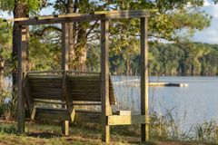 Wooden bench overlooking lake and boat dock royalty free stock images