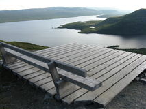 Wooden bench overlooking lakes. Empty wooden bench on viewpoint overlooking lakes in background Stock Photo