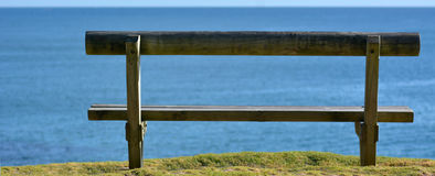 Wooden bench overlooking a sea view Stock Photography