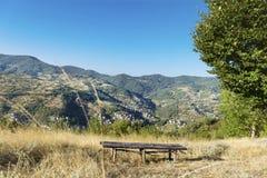 Wooden bench overlooks Rodopite mountain Stock Photo