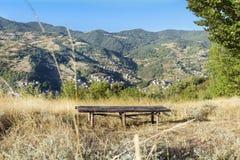 Wooden bench overlooks Rodopite mountain Stock Image