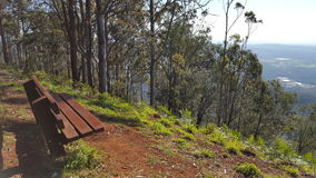 Wooden Bench overseeing scenic mountain view.  Royalty Free Stock Images