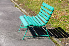 Wooden bench painted in green. Is placed along the path for pedestrians royalty free stock images