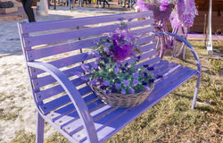 Wooden bench painted in purple. Wooden bench painted in purple and decorated with matching accessories stock photography