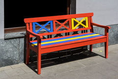 Wooden bench, painted in red, yellow and blue Royalty Free Stock Images