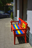 Wooden bench, painted in red, yellow and blue Royalty Free Stock Image