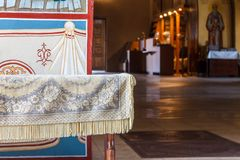 Wooden bench and painted wall in the interior of the Christian t. Wooden bench with cloth and painted wall in the interior of the Christian temple royalty free stock photos