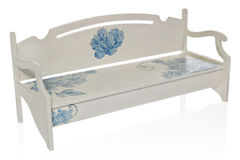 The wooden bench painted white with a pattern of blue flowers. Stock Images