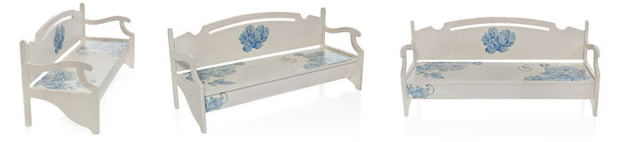 The wooden bench painted white with a pattern of blue flowers. Stock Photography