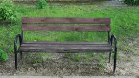Wooden bench in the park. Wooden bench in the park stock footage