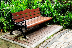 A Wooden bench in the park Royalty Free Stock Images