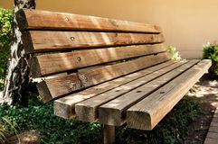 A wooden bench at the park Stock Photo