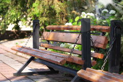 Wooden bench is in park Royalty Free Stock Photos