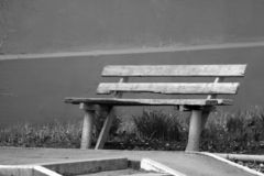 Wooden Bench in the park stock photography