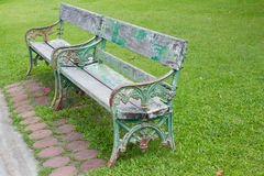 Wooden bench in park and green grass Royalty Free Stock Photos