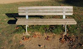 Wooden bench in a park. Wooden bench in the sun Stock Images