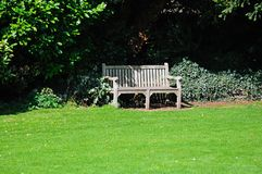 Wooden bench in park, Tewkesbury. Stock Photos