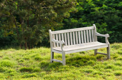 Wooden bench in the park with vintage style. Royalty Free Stock Image