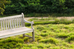 Wooden bench in the park with vintage style. Royalty Free Stock Photo