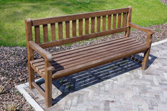 Wooden bench in park Stock Photos