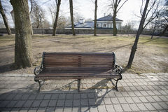 Wooden bench on path in park, Tallinn, Estonia, Europe Royalty Free Stock Image
