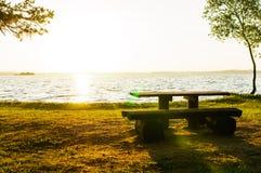 bench at river shore landscape stock photos