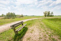 Wooden bench in a picturesque rural landscape Stock Photography