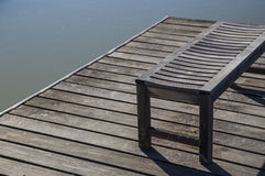 Wooden Bench on Pier or Dock Stock Photo