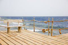 Wooden bench on the pier, seascape Stock Photo