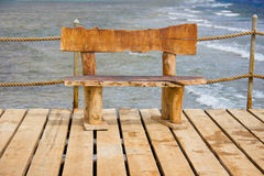 Wooden bench on the pier, seascape Stock Image