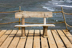 Wooden bench on the pier, seascape Stock Photos