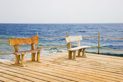 Wooden bench on the pier, seascape Royalty Free Stock Images