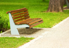 Wooden bench placed in peaceful park Royalty Free Stock Photo