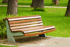 Wooden bench placed in peaceful park Royalty Free Stock Photography