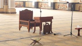The Wooden Bench in The Prayer Hall. There is a Wooden Bench in the Center of the Prayer Hall in the Mosque. A Microphone With the Stand is Near it. The Floor is stock video