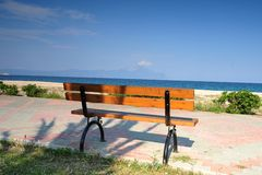 Wooden bench on the promenade at the seafront Royalty Free Stock Photo