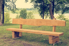 Wooden bench in the public park Royalty Free Stock Photography