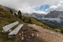 Wooden bench in Puez-Geisler Nature Park, Dolomites. Italy Royalty Free Stock Images
